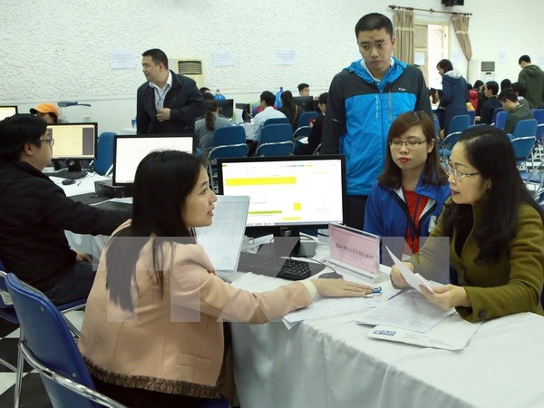 Hanoi names 77 companies with overdue tax payments hinh anh 1