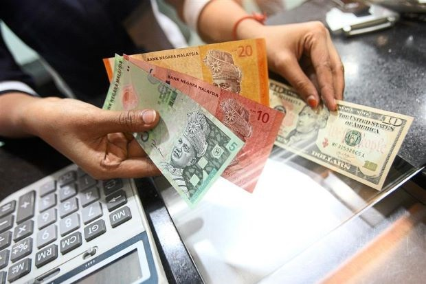 Malaysia to apply new exchange rate hinh anh 1