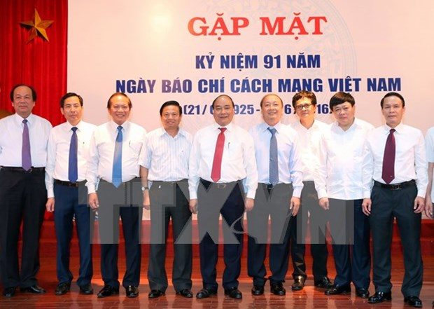 PM urges further press renovation hinh anh 1