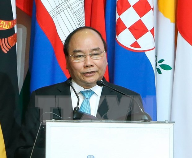 PM highlights importance of connectivity at 11th ASEM Summit hinh anh 1