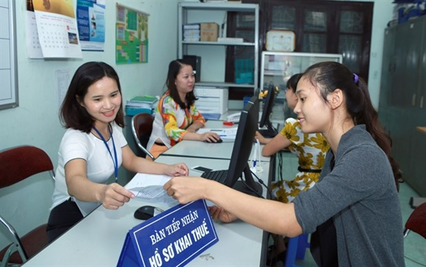 Tax incentives to help firms beat difficulties hinh anh 1