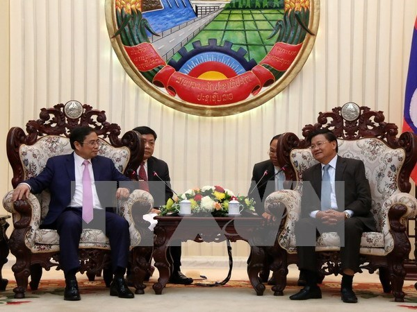 Vietnam, Laos Party organisation commissions look to push ties hinh anh 1