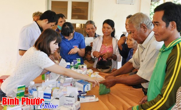 Overseas Vietnamese committee delegation works in Binh Phuoc hinh anh 1