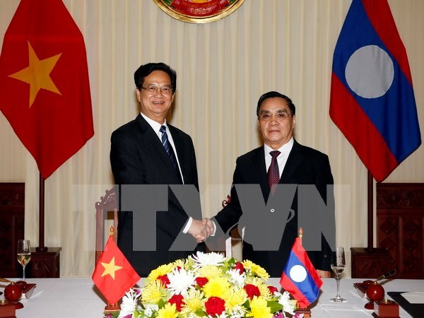 Vietnam leader's visit to Laos illustrates resolve to boost solidarity hinh anh 1