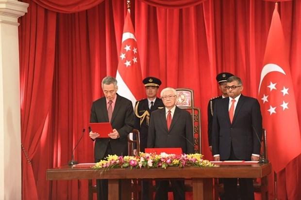 PM Nguyen Tan Dung congratulates Singaporean counterpart hinh anh 1