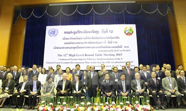 Laos opens round-table meeting to boost development hinh anh 1