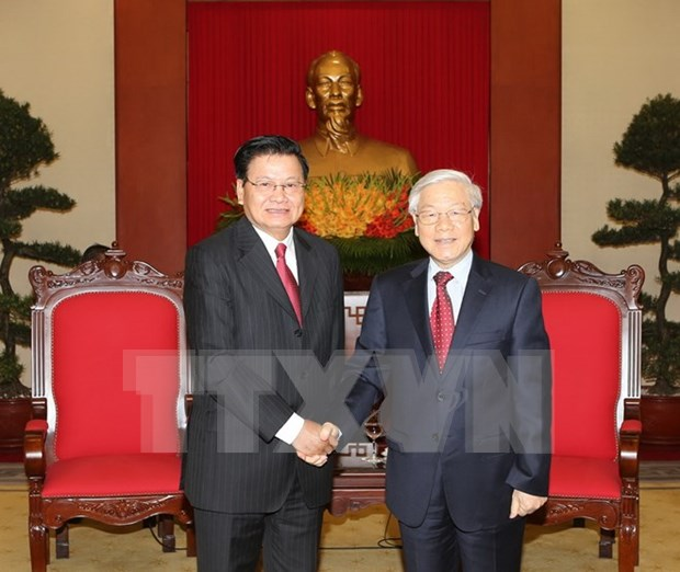 Party chief receives Lao Prime Minister hinh anh 1