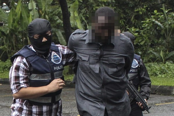 Malaysia arrests 14 suspected IS members hinh anh 1