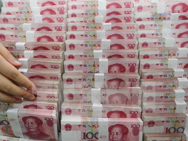 China's yuan depreciation likely to harm Vietnamese firms: experts hinh anh 1