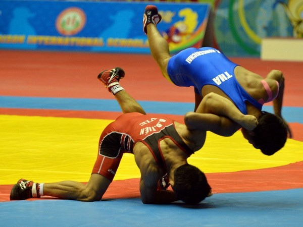 Wrestlers competing in Asian champs in Taipei hinh anh 1
