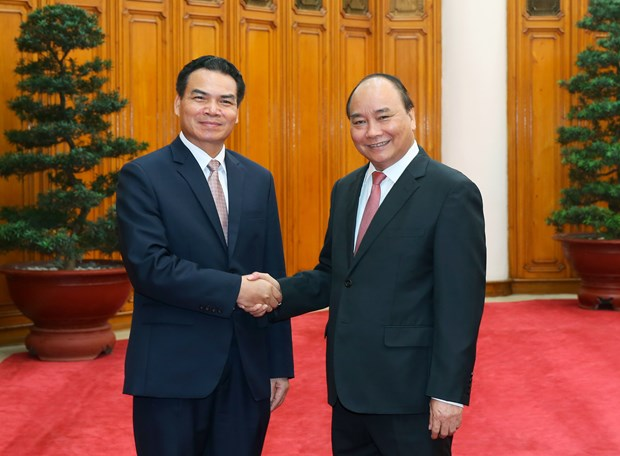 PM receives Lao minister, Chinese group chairman hinh anh 1