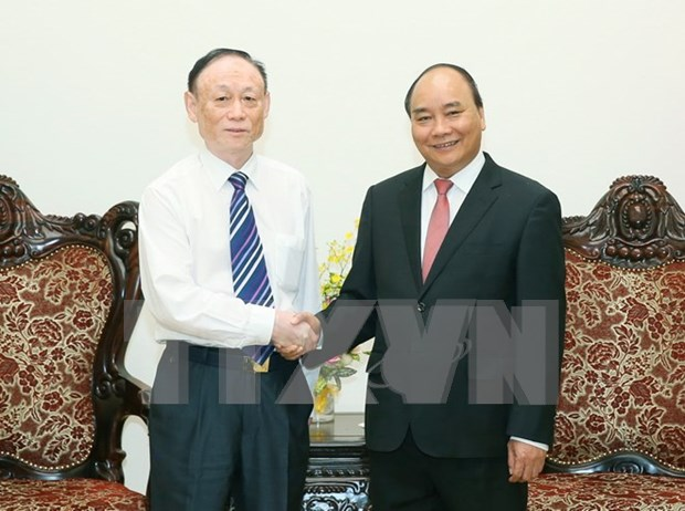PM receives Lao minister, Chinese group chairman hinh anh 2