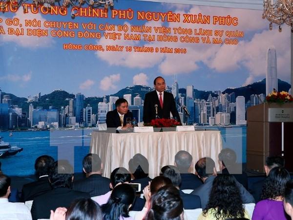 PM meets Vietnamese expatriates in Hong Kong, Macau hinh anh 1