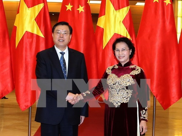 Chinese top legislator concludes official visit to Vietnam hinh anh 1