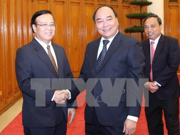 Deputy PM seeks Laos' support to Vietnam-invested projects hinh anh 1