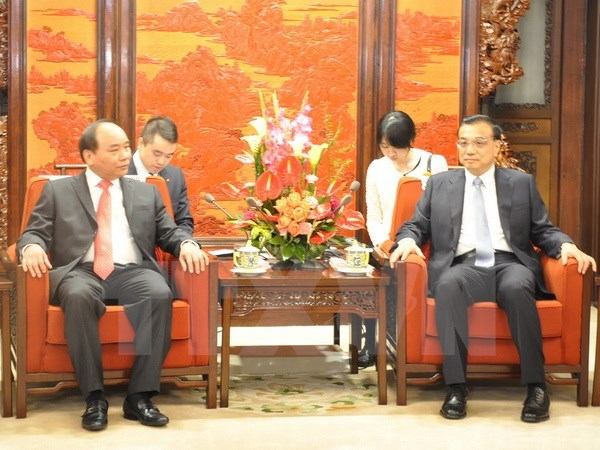 Deputy Prime Minister meets Chinese Premier hinh anh 1