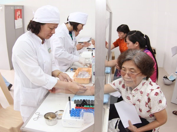 Hanoi targets to raise health insurance coverage hinh anh 1