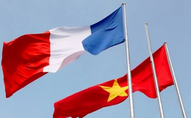 French PM pledges help to Vietnam in coping with climate change hinh anh 1