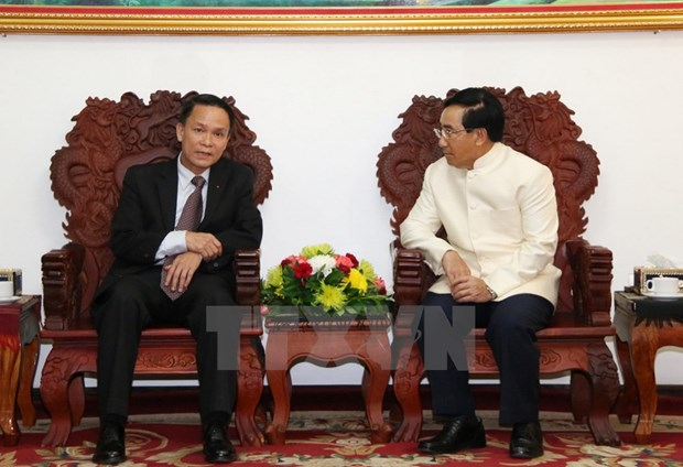 Lao Deputy PM thanks VNA for support to Lao News Agency hinh anh 1