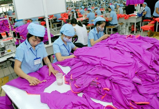 Enterprises anticipate opportunities brought by newly-signed TPP hinh anh 1