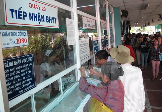 Number of health insurance holders surges over new hospital fees hinh anh 1
