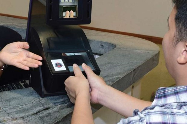 Singapore to scan visitors' fingerprints hinh anh 1