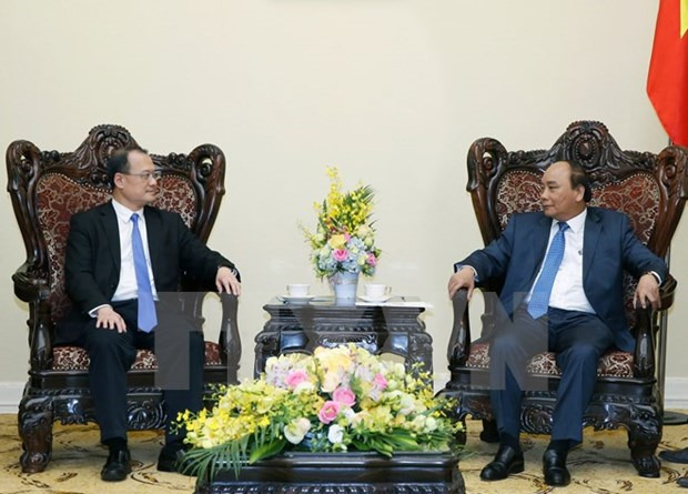 Prime Minister welcomes Hong Kong group's top executive hinh anh 1