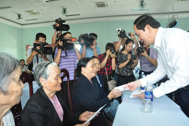 President asserts duty to care for revolutionary contributors hinh anh 1