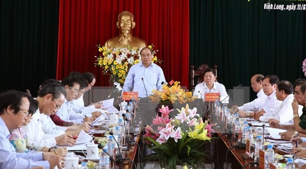 PM inspects agricultural restructuring in Vinh Long hinh anh 1