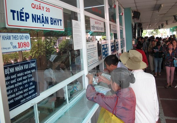 Agencies work harder for health insurance coverage expansion hinh anh 1