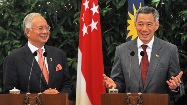 Singapore, Malaysia ink MoU on high-speed rail project hinh anh 1