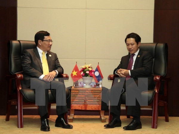 Deputy PM meets Lao, Brunei foreign ministers hinh anh 1