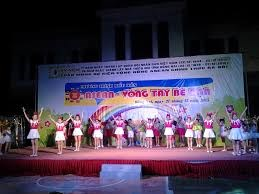 Int'l event gathers Vietnamese, Lao, Cambodian children hinh anh 1