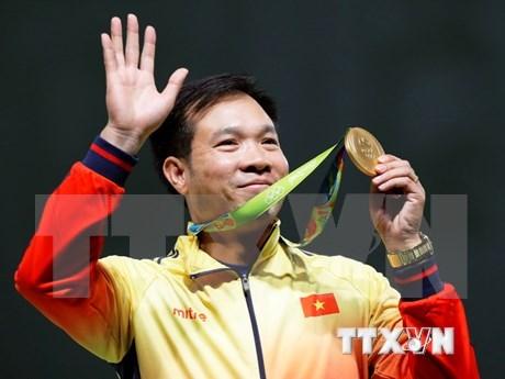 International media praise Hoang Xuan Vinh's Olympic victory hinh anh 1