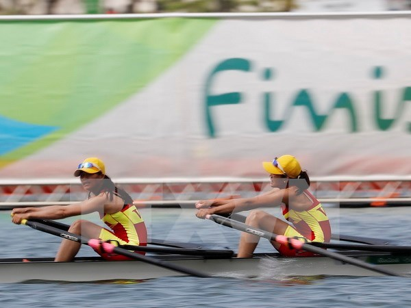 Rio 2016: VN rowers, badminton player have good performance hinh anh 1
