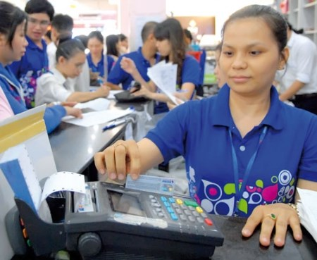 Government approves plan to reduce cash use hinh anh 1