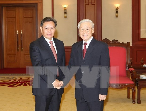 Party General Secretary welcomes Lao guest hinh anh 1