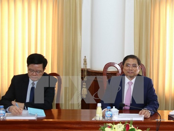 Vietnam, Laos Party organisation commissions enhance cooperation hinh anh 1