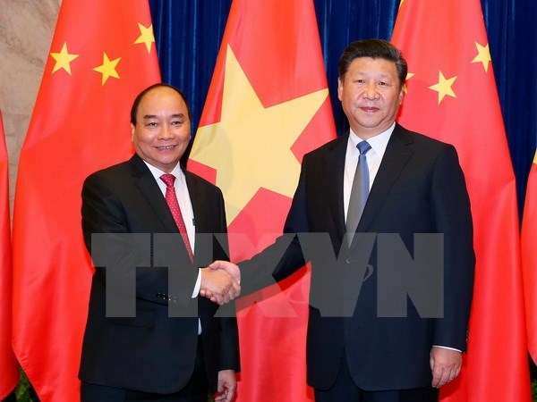 Vietnam treasures relations with China: PM hinh anh 1