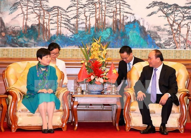 PM hosts Chinese friendship activitists in Beijing hinh anh 1