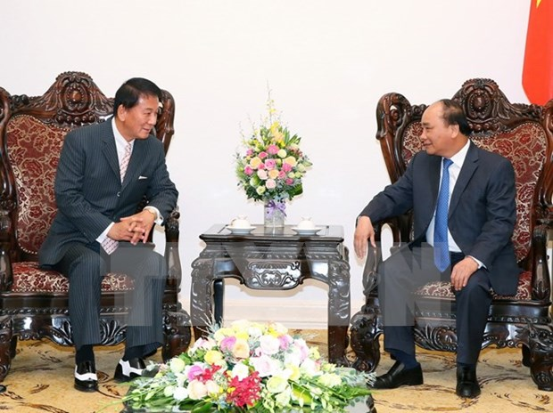 Prime Minister meets with WHO regional director, Japanese guest hinh anh 2