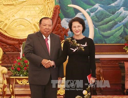 NA Chairwoman meets Lao Party General Secretary hinh anh 1