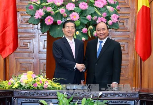 PM facilitates cooperation with Chinese public security ministry hinh anh 1