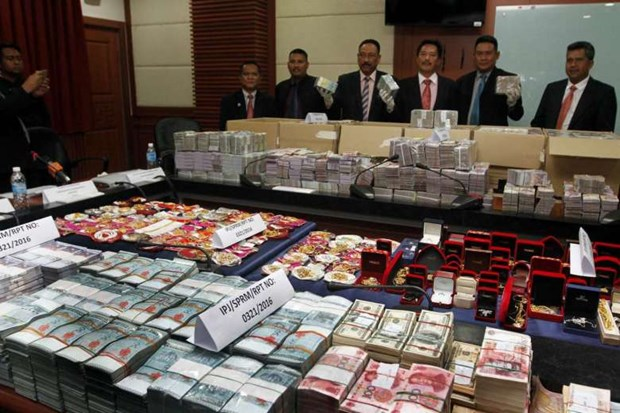 Malaysia seizes biggest-ever corruption cash hinh anh 1