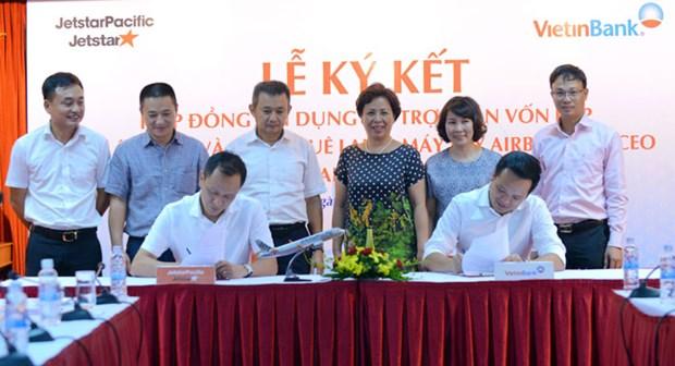Jetstar Pacific, Vietinbank sign deal to buy more aircraft hinh anh 1