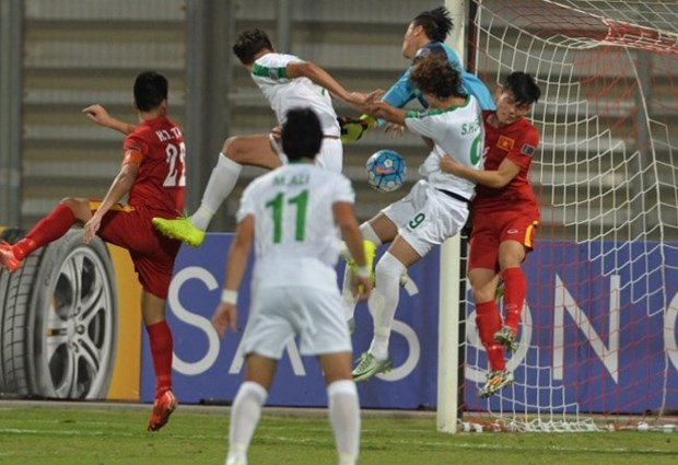 Vietnam tie 0-0 with Iraq, advance to Asian quarter-finals hinh anh 1