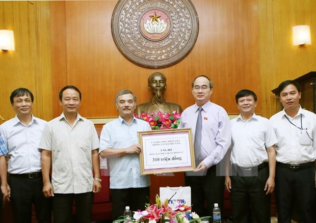 Vietnam News Agency supports flood victims in central region hinh anh 1