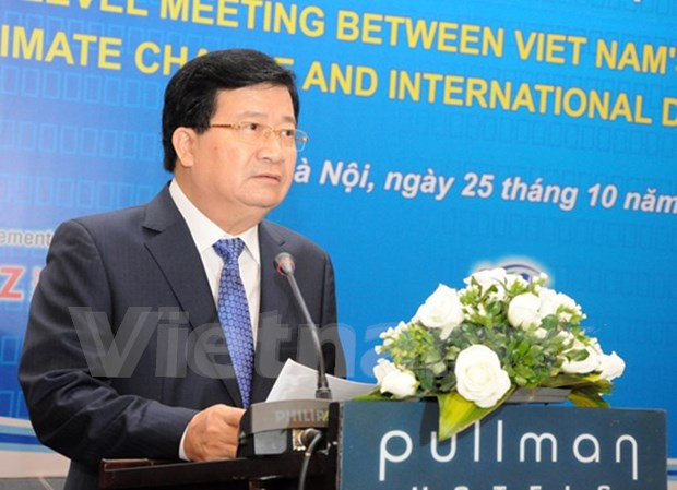 Vietnam holds climate change dialogue with development partners hinh anh 1