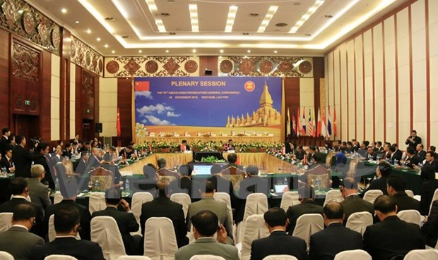 Vietnam beefs up procuracy cooperation with Laos, China hinh anh 1