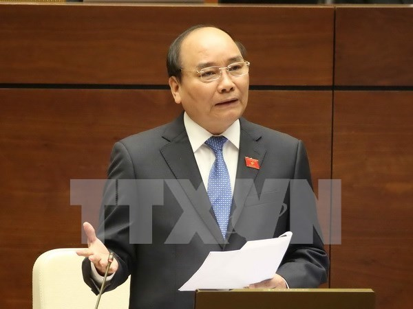 Prime Minister takes floor at NA hearing hinh anh 1